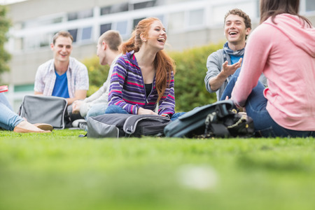 Group of young college students sitting in the park