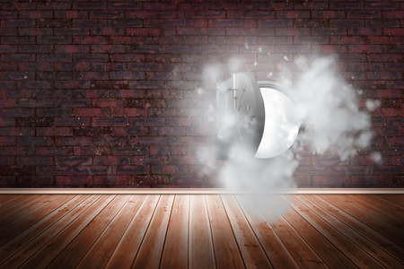 Open safe in dust cloud on brick lined wall