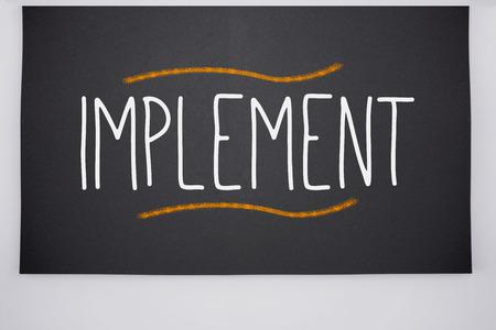 Photo pour The word implement written on big blackboard - image libre de droit