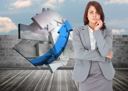 Focused businesswoman against brick lined wall covering half sky