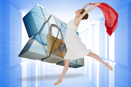 Young beautiful female dancer with red scarf against bright blue room with windows