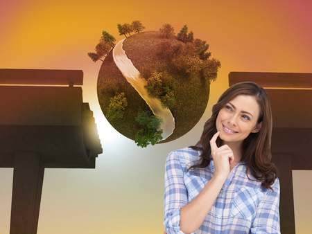 Composite image of thoughtful woman placing her finger on her chin on white background