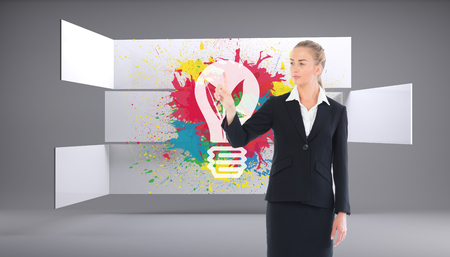 Composite image of young blonde business woman pointing on white background