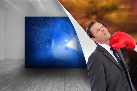 Composite image of businesswoman hitting colleague with her boxing gloves