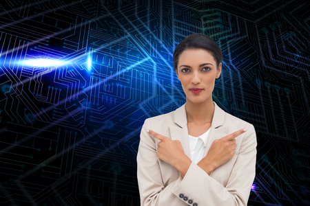Composite image of charismatic businesswoman with her arms crossed and fingers pointing