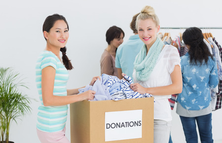 Group of young people with clothes donation