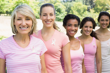 Group of female volunteers participating in breast cancer awareness