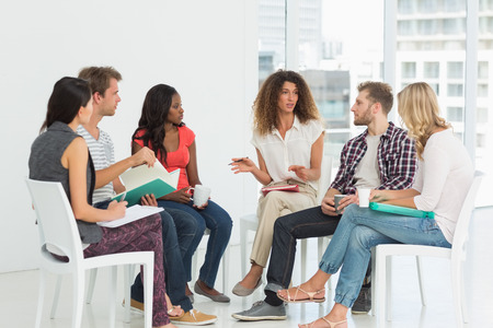 Therapist speaking to a rehab group at therapy session