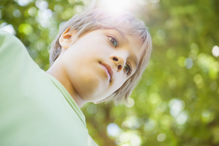 Low angle view of a young boy standing at the park