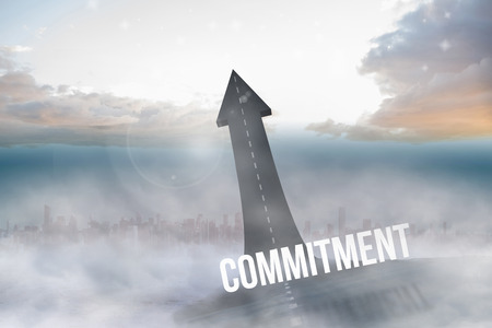 The word commitment against road turning into arrow