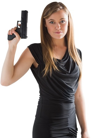Femme fatale pointing gun up on white background