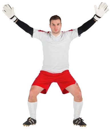 Goalkeeper in white ready to save on white background