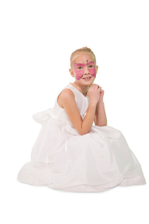 Happy little girl in butterfly face paint on white background