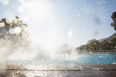 View of splashing water in swimming pool