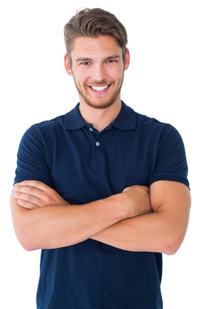 Photo pour Handsome young man smiling with arms crossed on white background - image libre de droit