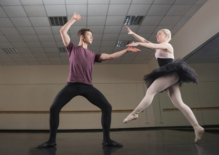 Ballet partners dancing gracefully together in the ballet studio