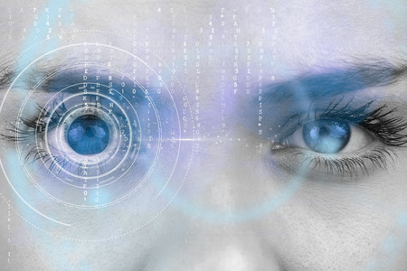 Composite image of close up of female blue eyes against interface