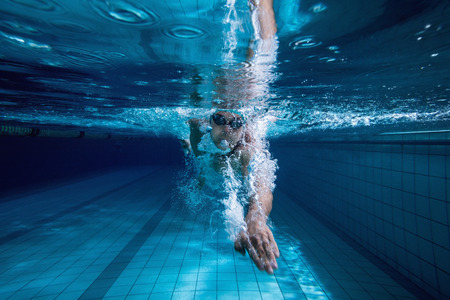 Photo for Fit swimmer training by himself in the swimming pool at the leisure centre - Royalty Free Image