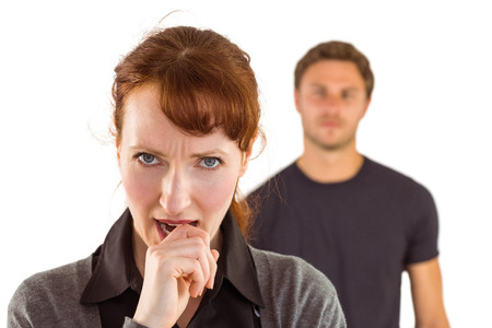 Worried woman with man behind on white background