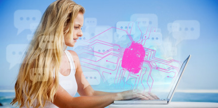 Pretty blonde using her laptop at the beach against fingerprint on circuit board