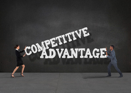Composite image of business team standing and pushing against buzz words in room