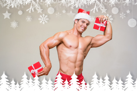 b0eac2b5e0b9c Shirtless macho man in santa hat holding gifts against fir tree forest and  snowflakes