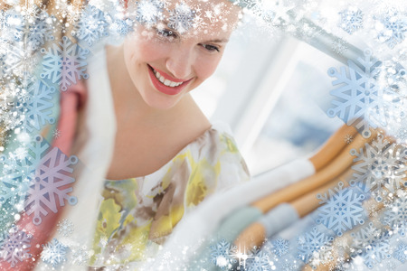Beautiful female customer selecting clothes at store against snow