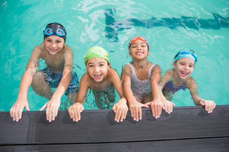 Photo pour Cute swimming class in the pool at the leisure center - image libre de droit