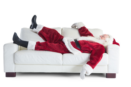 Photo pour Father Christmas sleeps on a couch on white background - image libre de droit