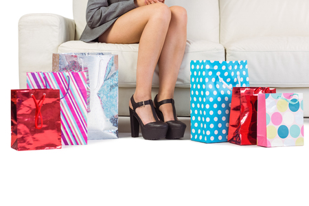 Woman with purchases and shopping bag on the floor at home