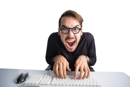 Excited businessman typing on keyboard on white background