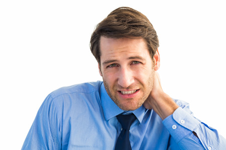 Businessman having a sore neck on white background
