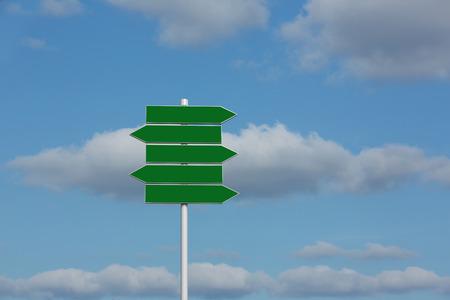 Green signpost against sky