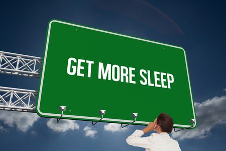 The word get more sleep and thinking businesswoman against sky