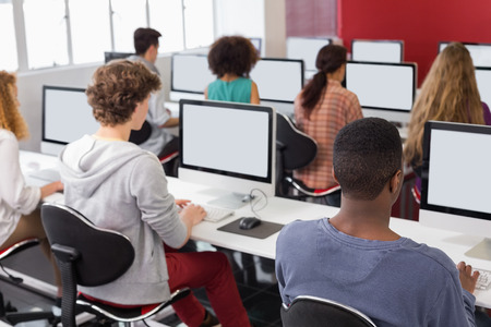 Photo for Students working in computer room at the college - Royalty Free Image