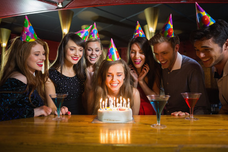 Photo for Friends celebrating a birthday together at the nightclub - Royalty Free Image