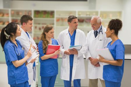 Photo pour Medical professor talking with students at the university - image libre de droit