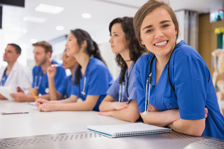 Photo pour Medical student smiling at the camera during class at the university - image libre de droit