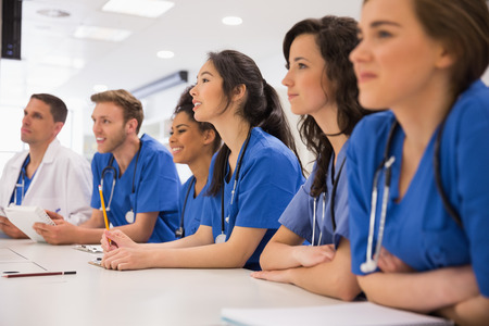 Photo for Medical students listening sitting at desk at the university - Royalty Free Image