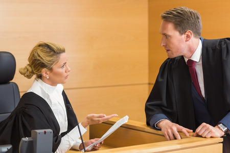 Lawyer speaking with the judge in the court room