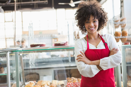 Photo for Pretty employee posing with arms crossed at the bakery - Royalty Free Image