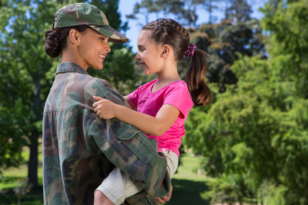 Photo for Soldier reunited with her daughter on a sunny day - Royalty Free Image
