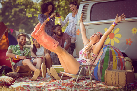 Photo pour Carefree hipster having fun on campsite at a music festival - image libre de droit