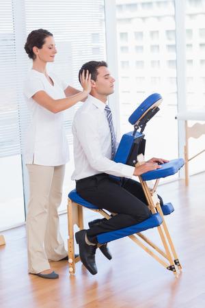 Businessman having head massage in medical office