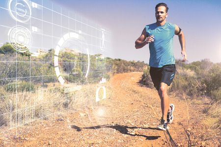 Athletic man jogging on country trail against fitness interface