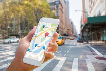 Man using map app on phone against new york street