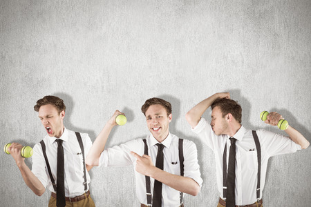 Nerd with dumbbell against white and grey background
