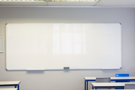 Empty classroom in the college with large white board