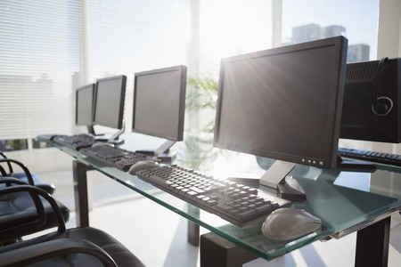 Foto de composite image of computer in front of window in office - Imagen libre de derechos