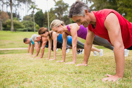 Photo for Happy athletic group training on a sunny day - Royalty Free Image